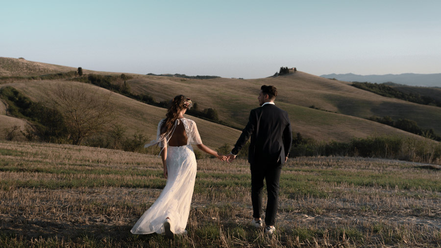 WAVE Tuscany elopement heand in heand